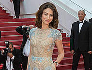 Olga Kurylenko in see thru dress at premiere