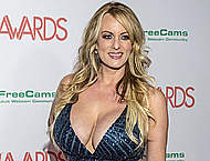Busty Stormy Daniels shows deep sexy cleavage