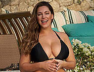 Busty Kelly Brook in black bikini poolside