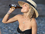 Elsa Pataky in black bikini on a beach
