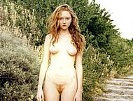 Model Lily Cole posing fully nude in nature