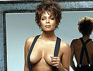 Young Janet Jackson posing sexy and braless