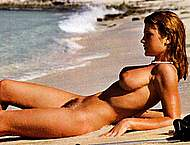 Adrienne Mandie fully nude on the beach scans