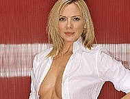 Kim Cattrall sexy and braless posing scans